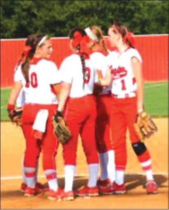 Courtesy Photo • Jamon Shipley - KHS Players from the Kingston fastpitch softball team meet at the mound in a game during the 2018 season. The squad is completing their preparations for the 2019 season, which begins later this week.