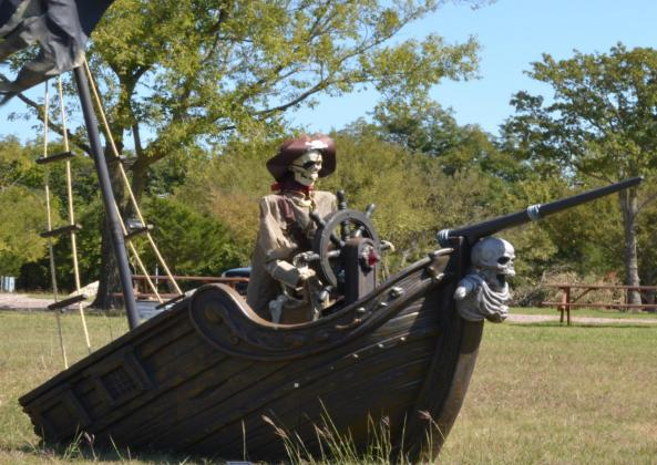 A pirate skeleton and a skeleton driving a hearse are a few of the things ready to greet anybody wishing to visit the McBride RV park. Jessie Pearson • The Madill Record