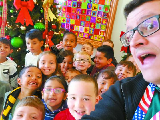 Students from Mrs. Courtney Sharp's kindergarten class take a selfie with Madill Record managing editor Matt Caban during the Madill Public Schools' Eighth Annual Joyce Coleman Christmas with the Kids on Dec. 17.