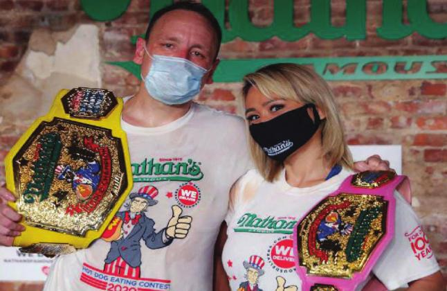 Competitive eaters Joey Chestnut and Miki Sudo after winning their respective divisions with new world records at the Nathan's Famous Hot Dog Eating Contest on Saturday. Chestnut at 75 hot dogs in 10 minutes, winning him his 13th title. Sudo ate almost 49 dogs to snag the women's title. Courtesy photo