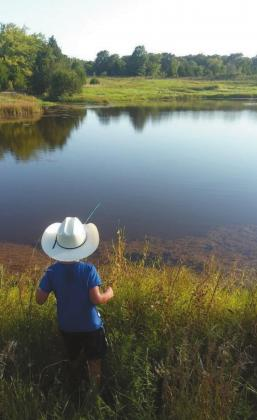 Gunnison Rockwell (age 5) fishing for bass in his great grandpa's farm pond in Okfuskee County. Courtesy photo