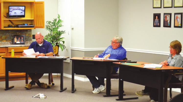 Public Schools superintendent Larry Case (center) speaks during the May 11 MPS Board of Education meeting at the MPS Administrative Center Conference Room. At left is Mark Glenn, board member, and at right is Carol Combs, MPS treasurer. Matt Caban • The Madill Record Madill