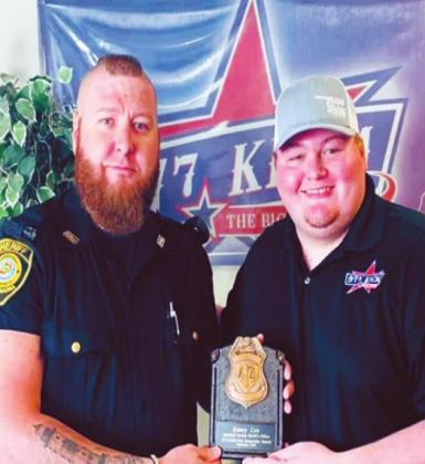 Marshall County Deputy Kasey Cox and KCIM DJ Bryson holding the First Responder Friday award. Cox was honored with being the first one from the Marshall County Sheriff's Office to receive the award. Courtesy photo