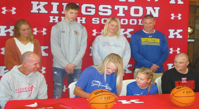 Avri Weeks, a senior at Kingston High School, signs her intent to play basketball for Southeastern Oklahoma State University for the fall 2021 season. She follows a long line of family members who have played for SE. Brent Smith • The Madill Record