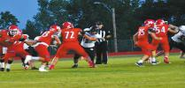 Kingston running back Brandon Watson (#33) takes the handoff from quarterback Jase Hayes (#6) as fullback Matt Flesher (#35) and offensive linemen Jakey Williams (#72) and Grant Holmes (#54) open a hole in the Plainview front. Linda Holmes