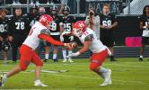 Running back Brandon Watson (#33) takes the handoff from quarterback Jase Hayes (#6) while Dakota Beshirs (#62) and the rest of the offensive line pave the way for Watson's 200-yard night vs. Lone Grove. Linda Holmes